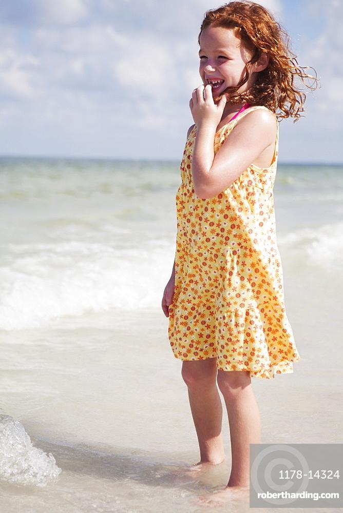 Girl wading in ocean