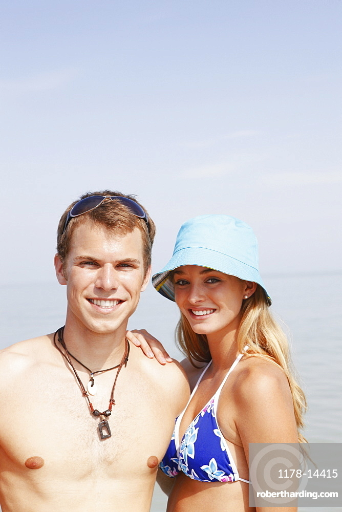 Young couple posing at beach