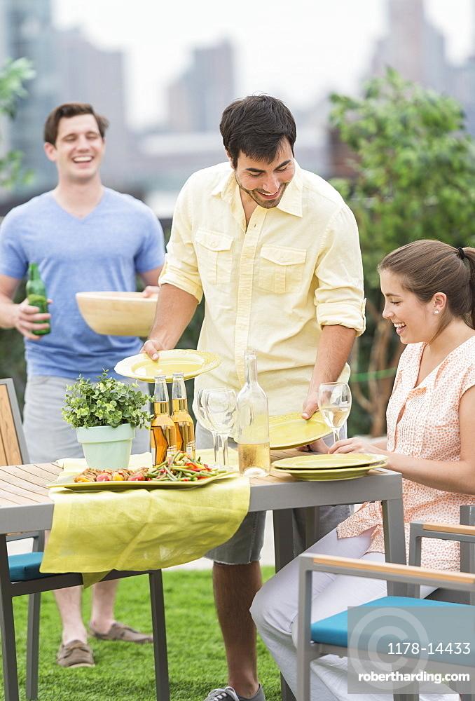 Friends enjoying barbecue in garden