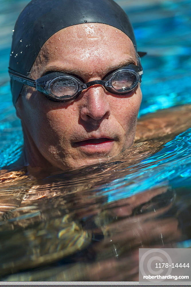 Portrait of swimmer wearing cap and goggles
