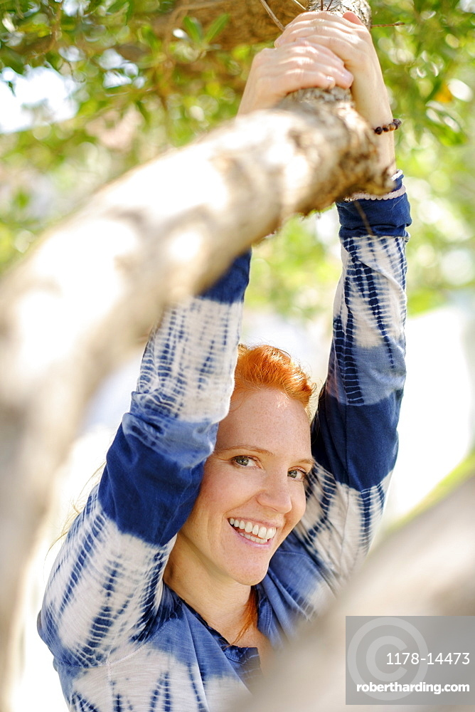 Portrait of woman holding branch