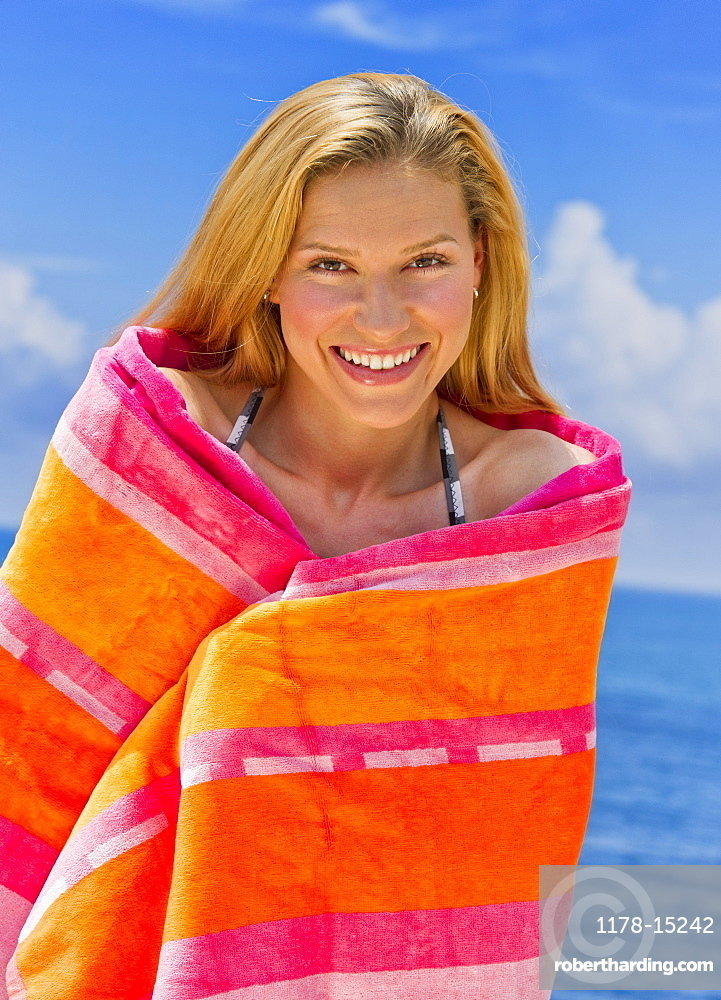 Portrait of woman wrapped in towel