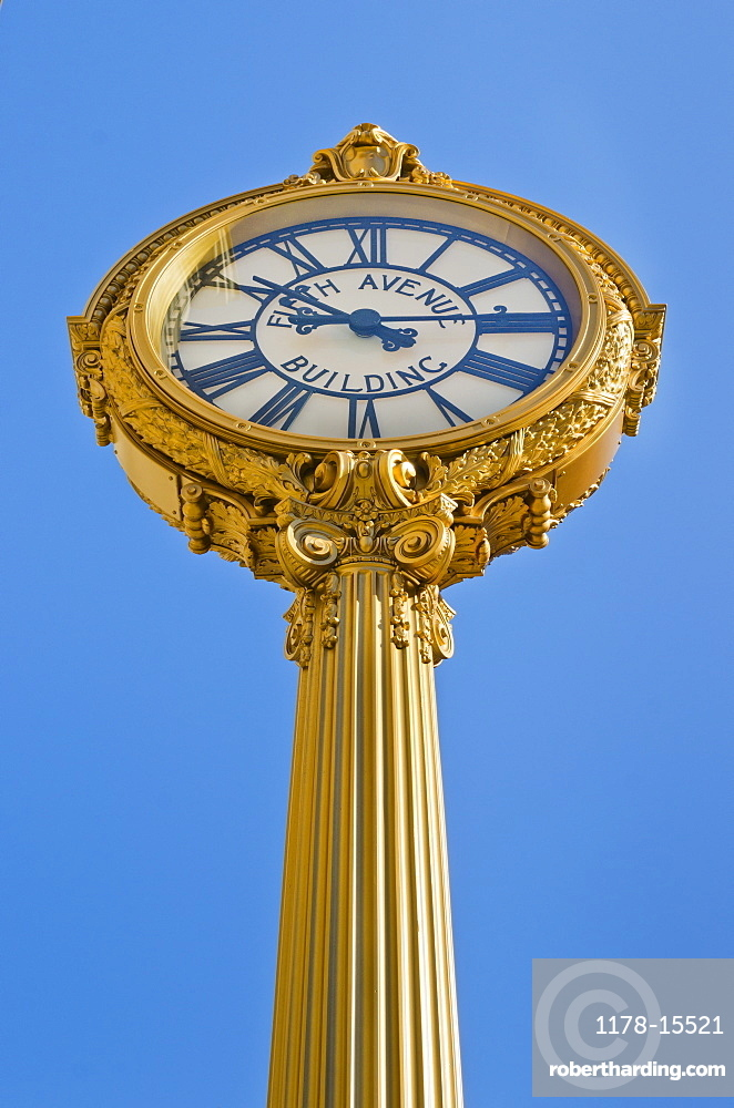 Antique clock against clear sky