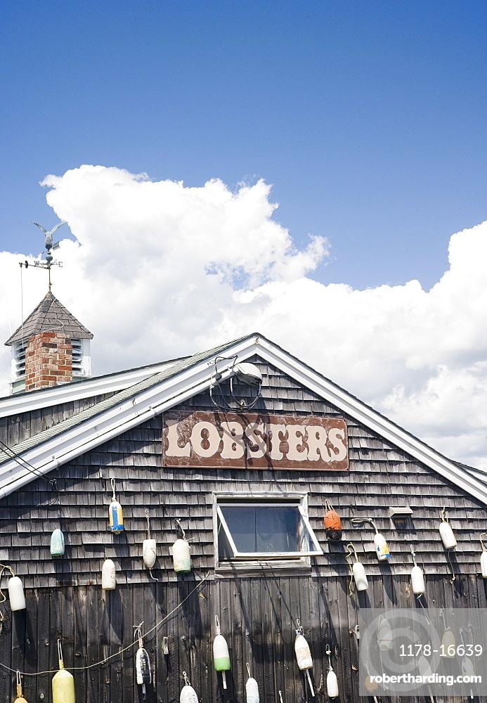 Buoys hanging on shingled building, Maine, United States
