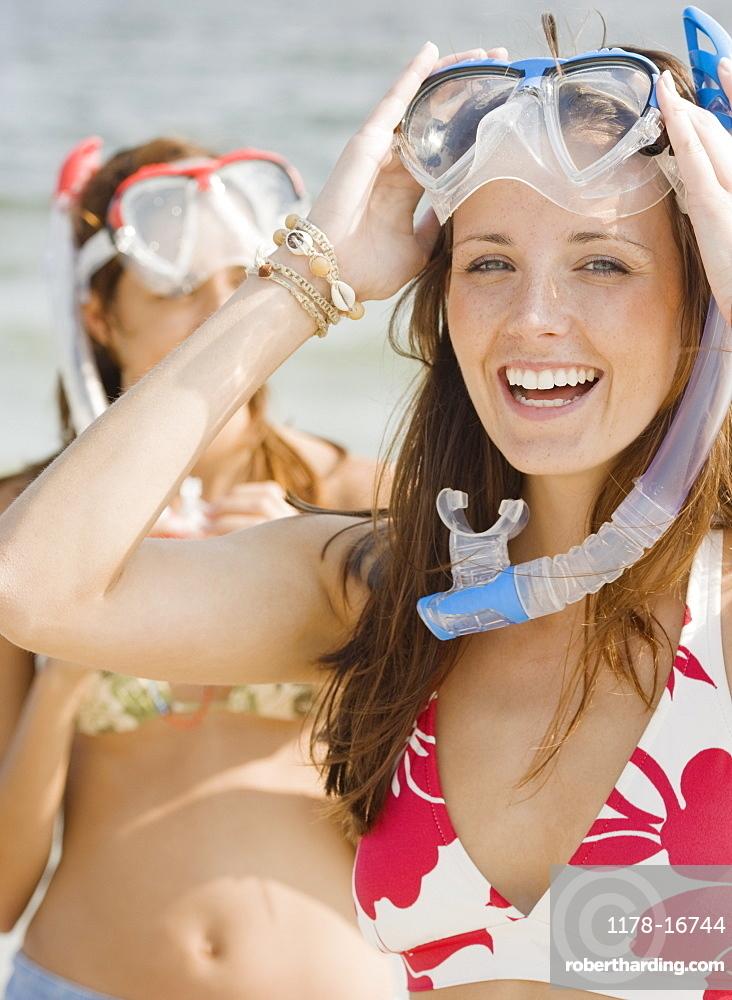 Young women wearing snorkeling gear