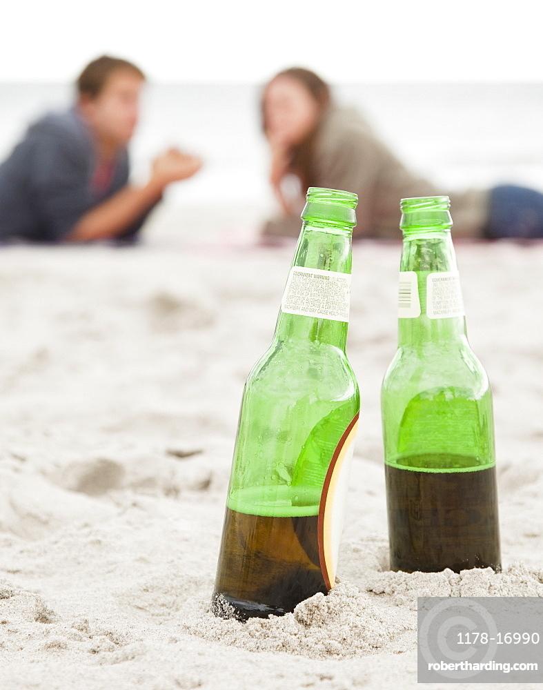 Bottles in sand