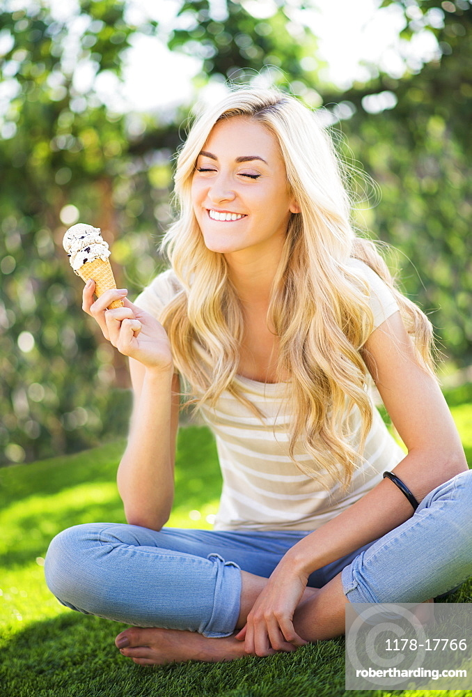 Portrait of teenage girl (16-17) eating ice cream
