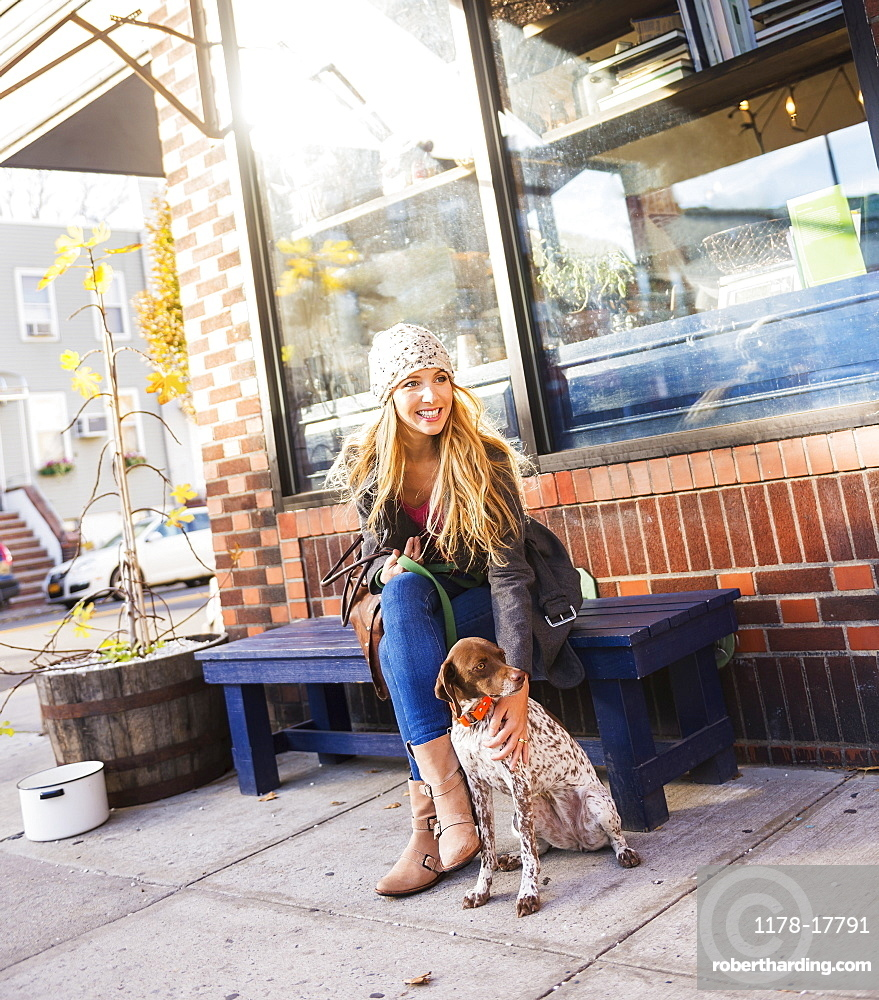 Portrait of blond woman with dog, USA, New York City, Brooklyn, Williamsburg