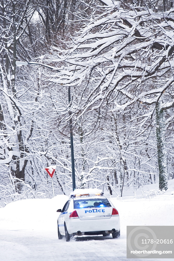 USA, New York City, police car on snowy road