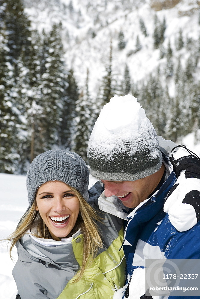 A couple outdoors in the snow