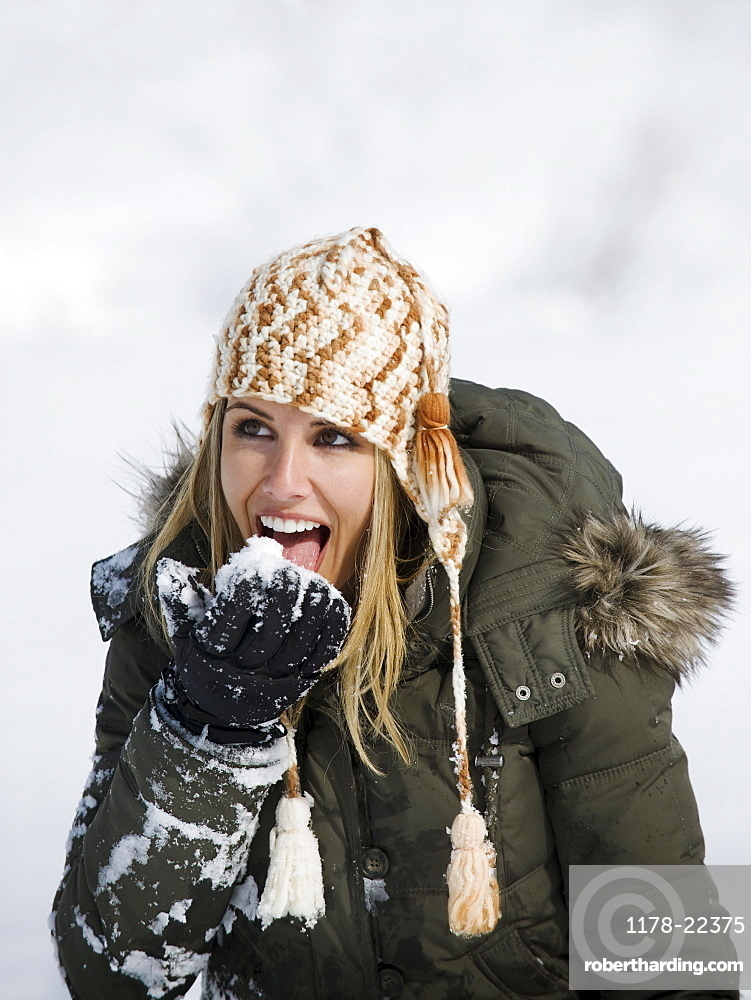 A woman eating snow