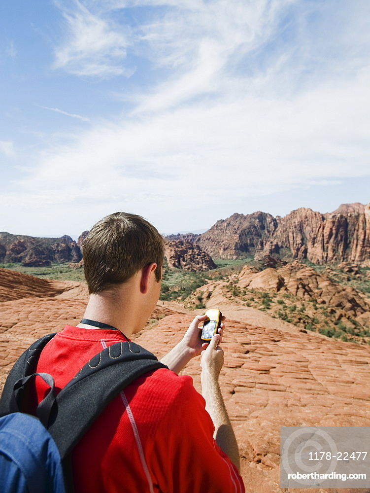A man at Red Rock holding a GPS