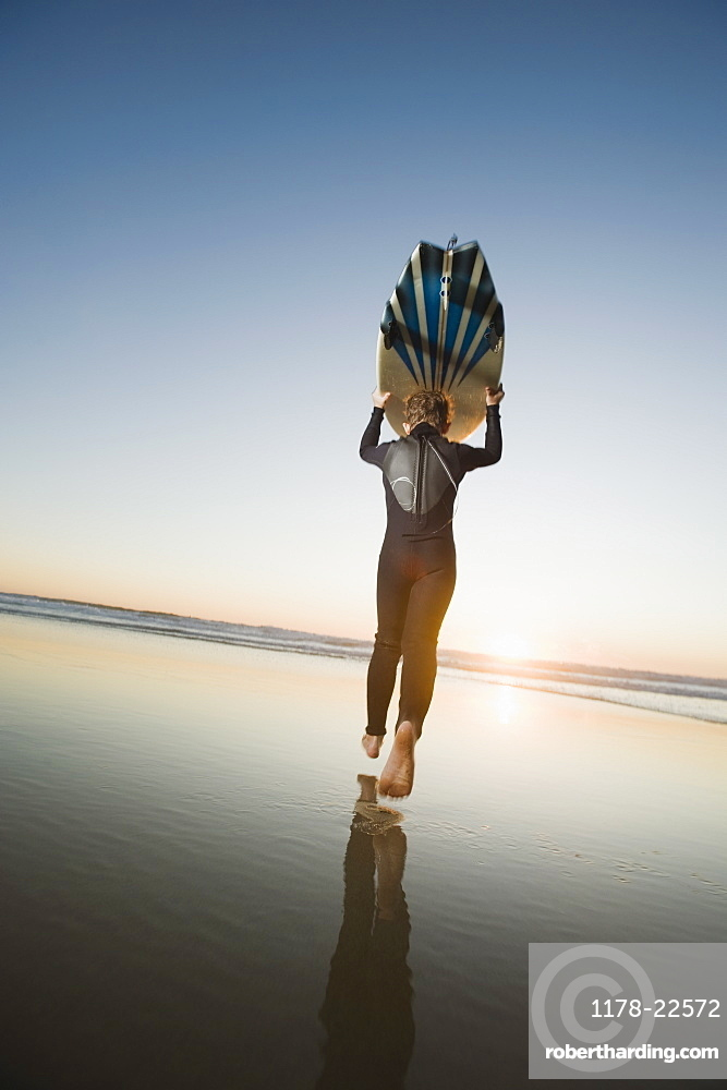 Child holding surfboard