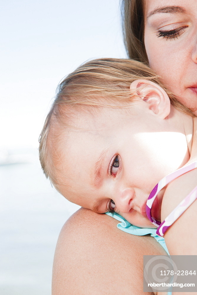 Mother with baby daughter (12-18months) hugging