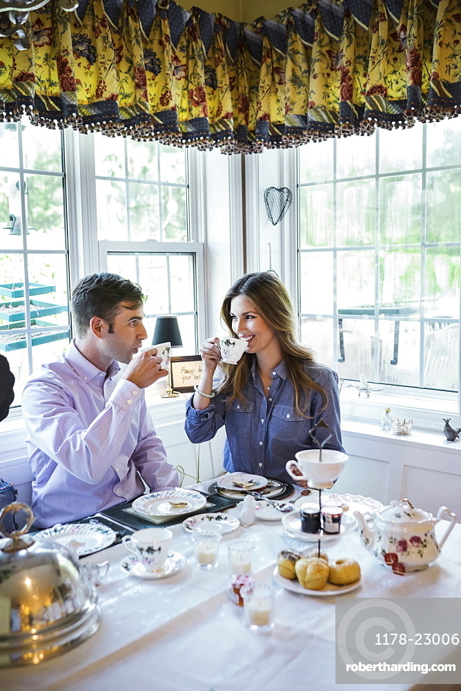 Couple eating together in dining room