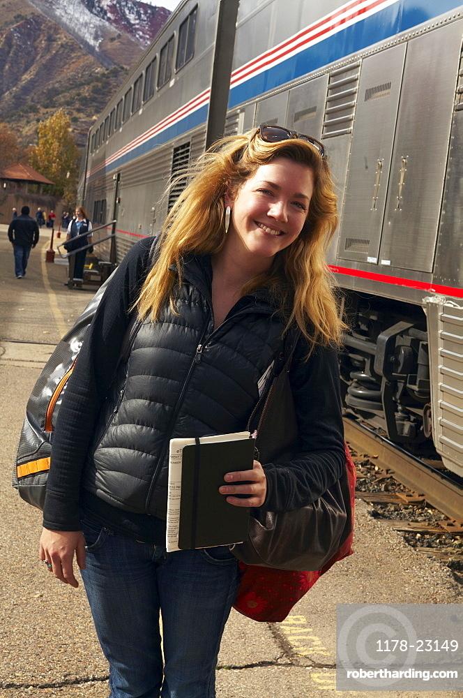 Woman smiling at train station, Glenwood Springs, Colorado, USA