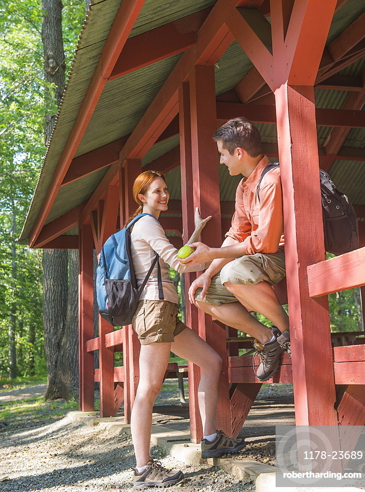 USA, New Jersey, Mendham, Couple resting during hiking in forest, USA, New Jersey, Mendham
