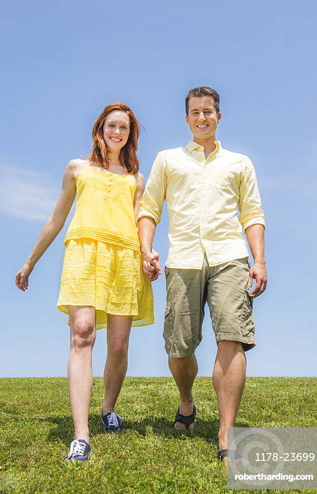 Couple walking on meadow, USA, New Jersey, Mendham
