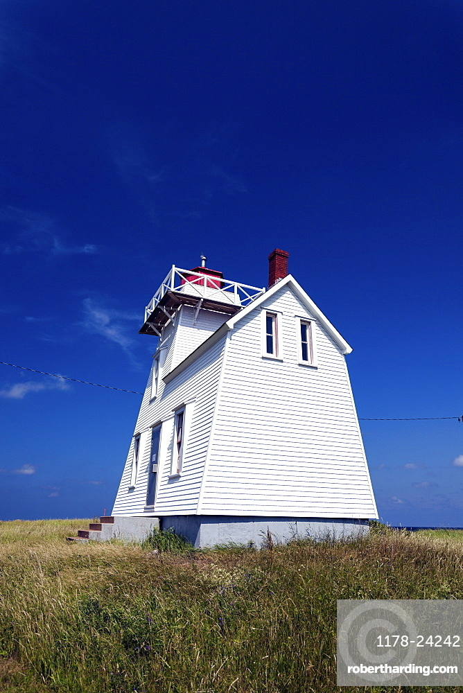 North Rustico Harbor Lighthouse against blue sky, Prince Edward Island, New Brunswick, Canada
