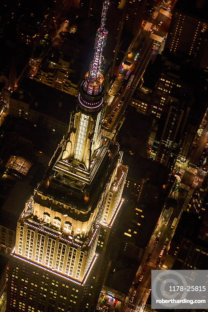 USA, New York, New York City, Aerial view of illuminated Empire State Building at night
