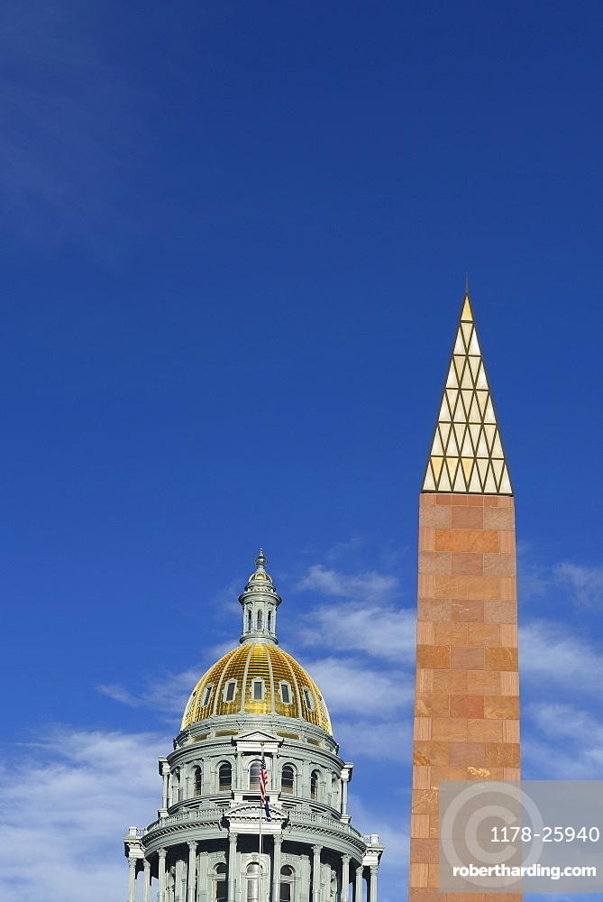 USA, Colorado, Denver, Capitol State building and Veterans monument against blue sky