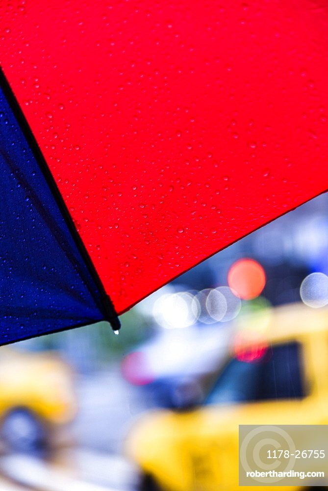 Close up of umbrella on rainy day