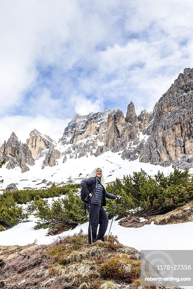 Woman hiking on Giau Pass in Dolomites, Passo Giau, Belluno, Italy