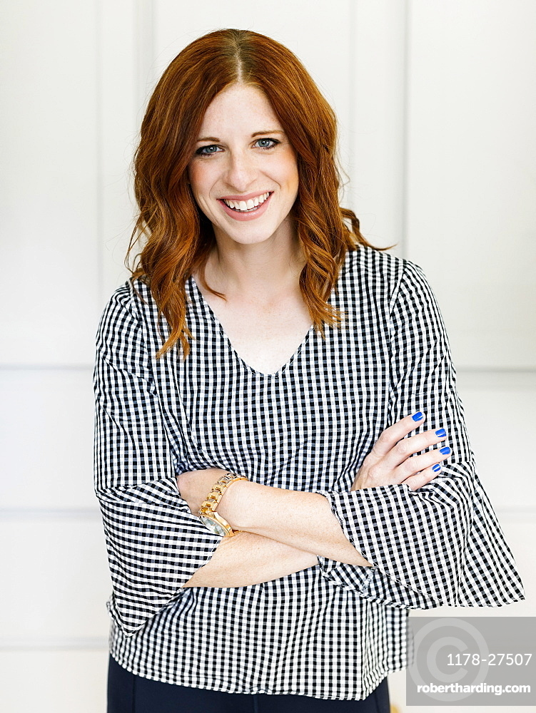 Smiling woman wearing checked top