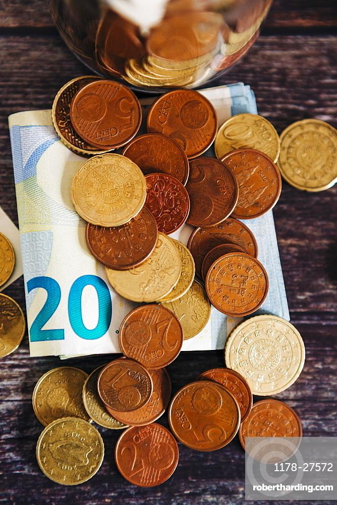 Euro coins on twenty Euro note