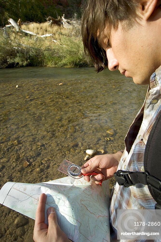 Hiker checking his map