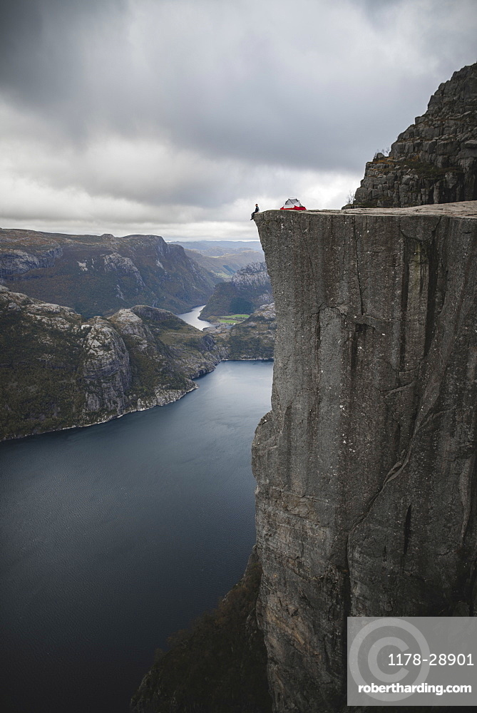 Person and tent on Preikestolen cliff in Rogaland, Norway
