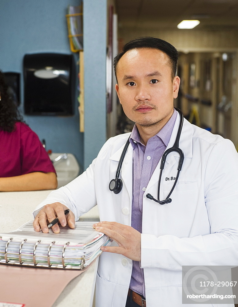 Doctor next to paperwork on bench