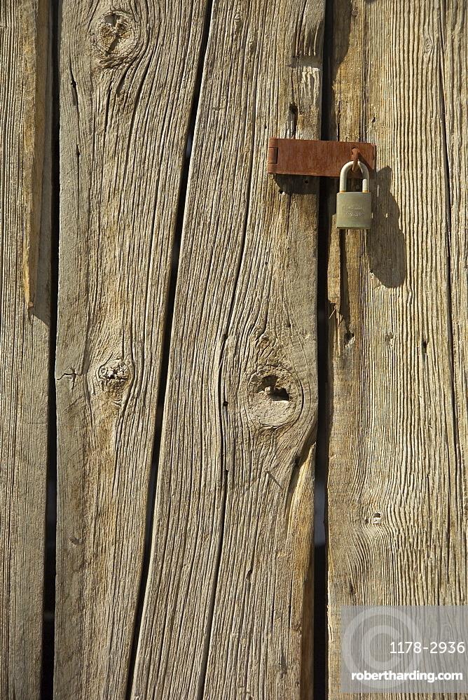 Padlock on a barn door
