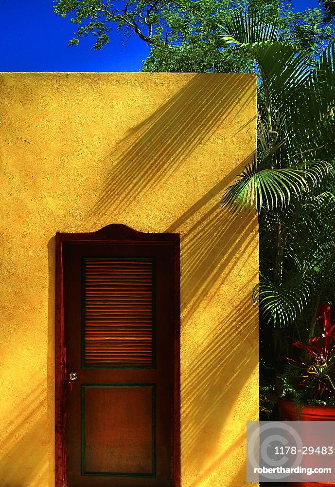 Morocco, Marrakesh, Wooden door in yellow building