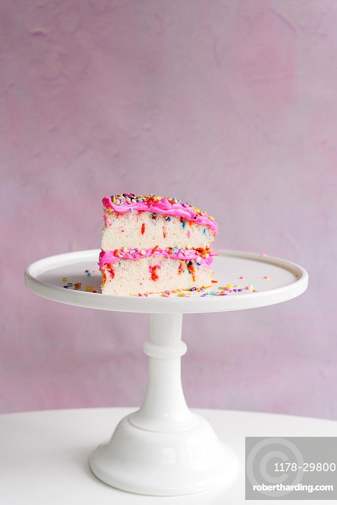 Slice of festive cake on cake stand