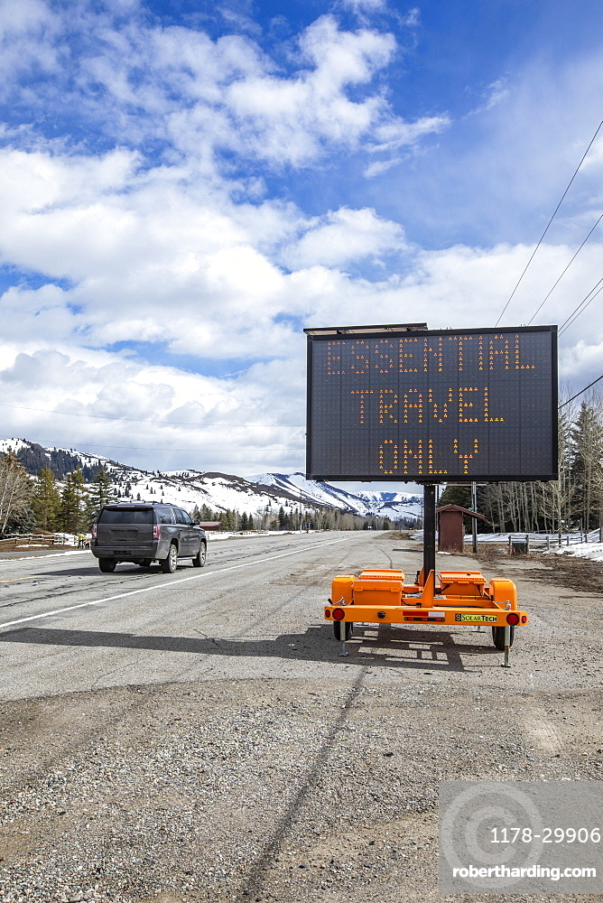 USA, Idaho, Sun Valley, COVID_19 lockdown on travel electronic sign on roadside
