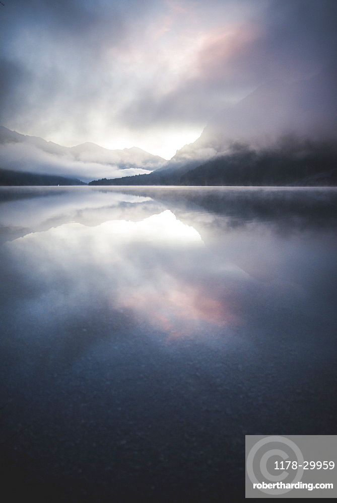 Austria, Plansee, Lake Plansee in fog at sunrise in Austrian Alps