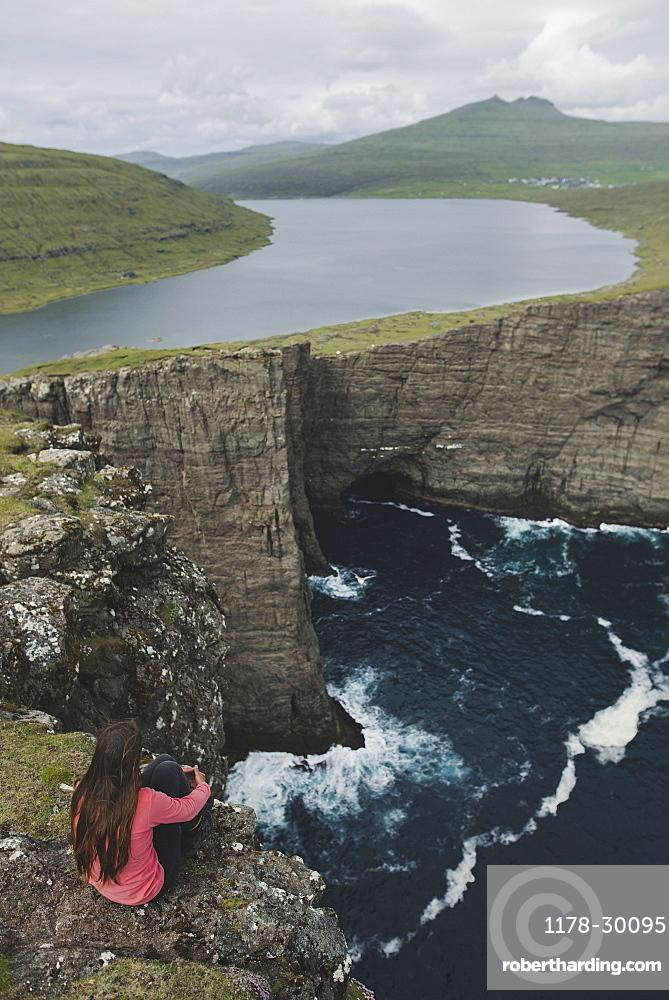 Denmark, Faroe Islands, Sorvagsvatn lake, Woman looking at dramatic landscape