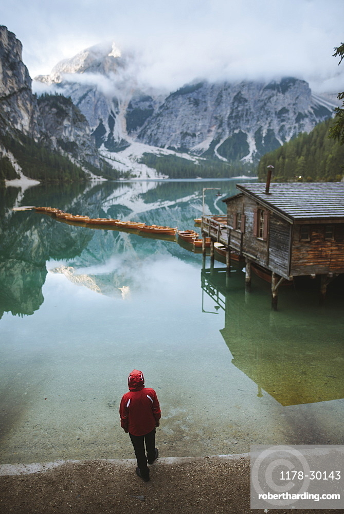 Italy, Man standing at Pragser Wildsee in Dolomites