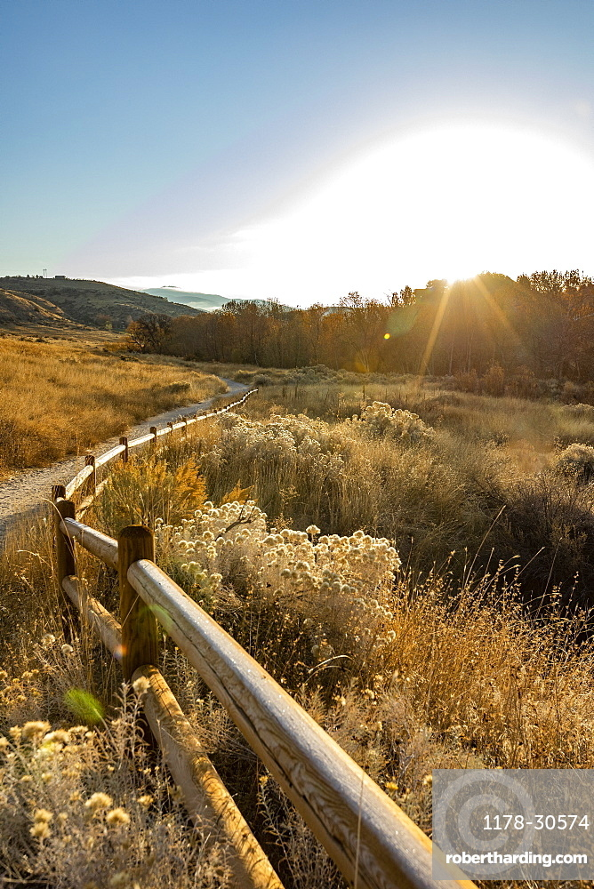 USA, Idaho, Boise, Path along fence in Military Reserve landscape
