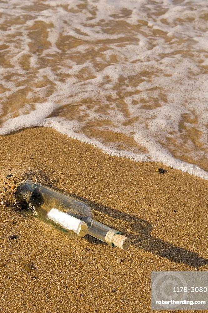 Message in a bottle on beach