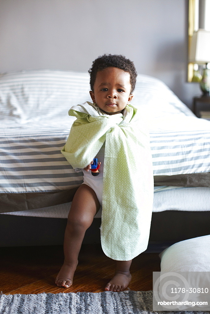 African American boy wrapped in blanket