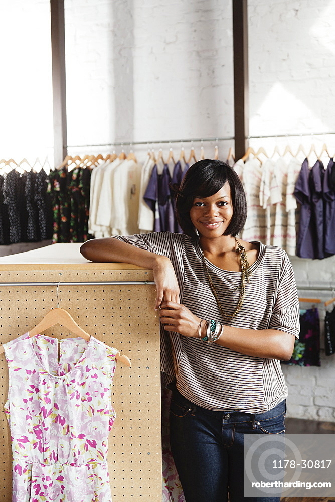African American woman working in clothing store