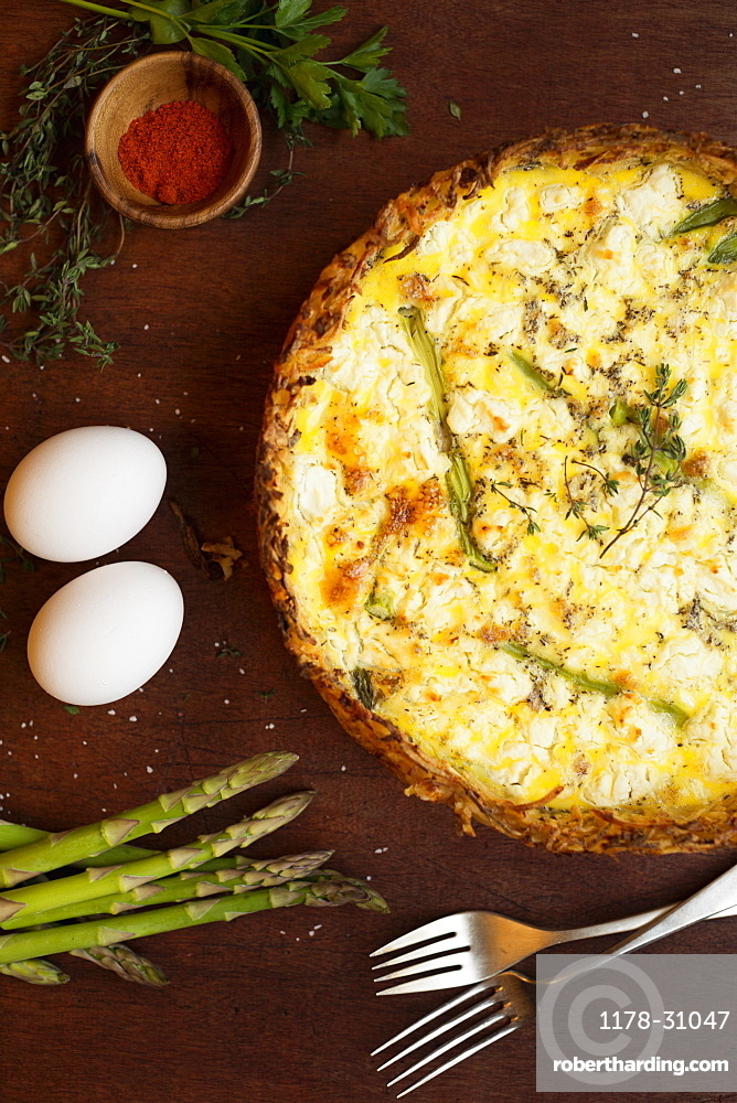 Quiche with ingredients of eggs, asparagus, paprika and thyme