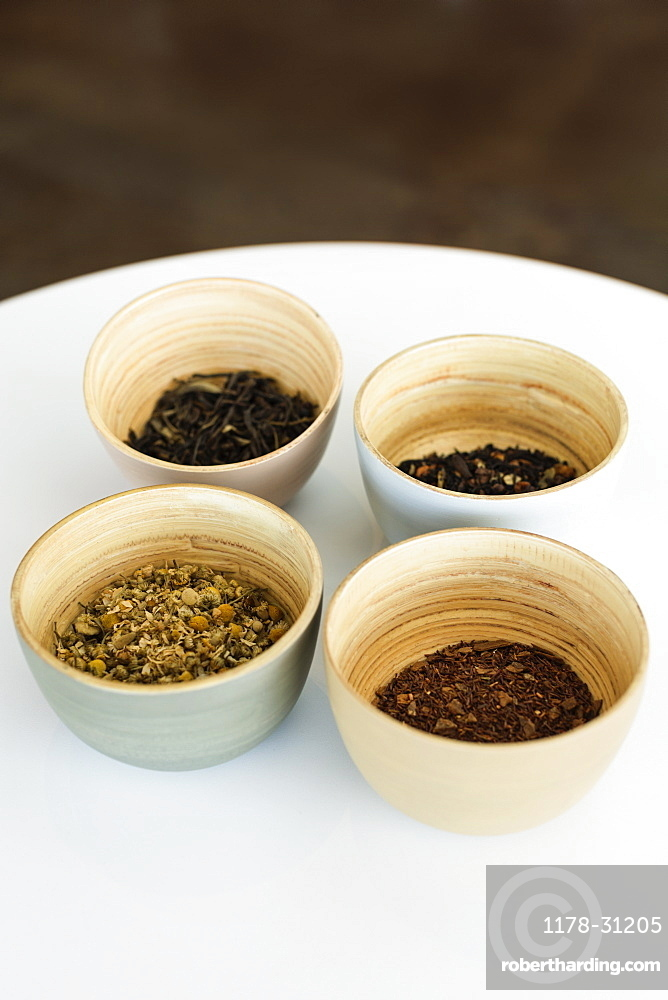 Selection of loose leaf teas in bowls, close-up