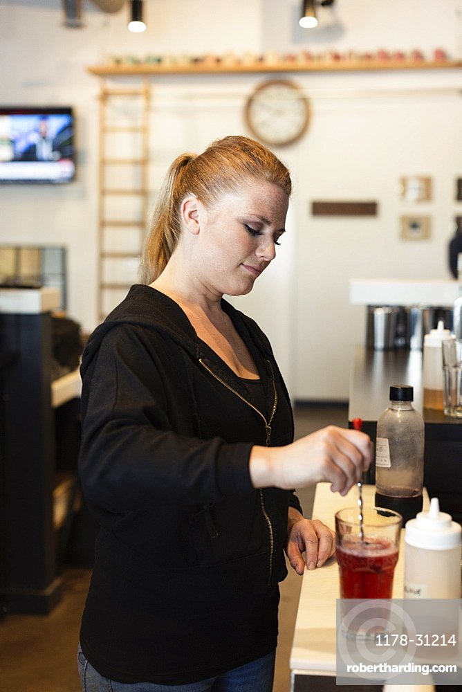 Coffee shop barista making fruit tea