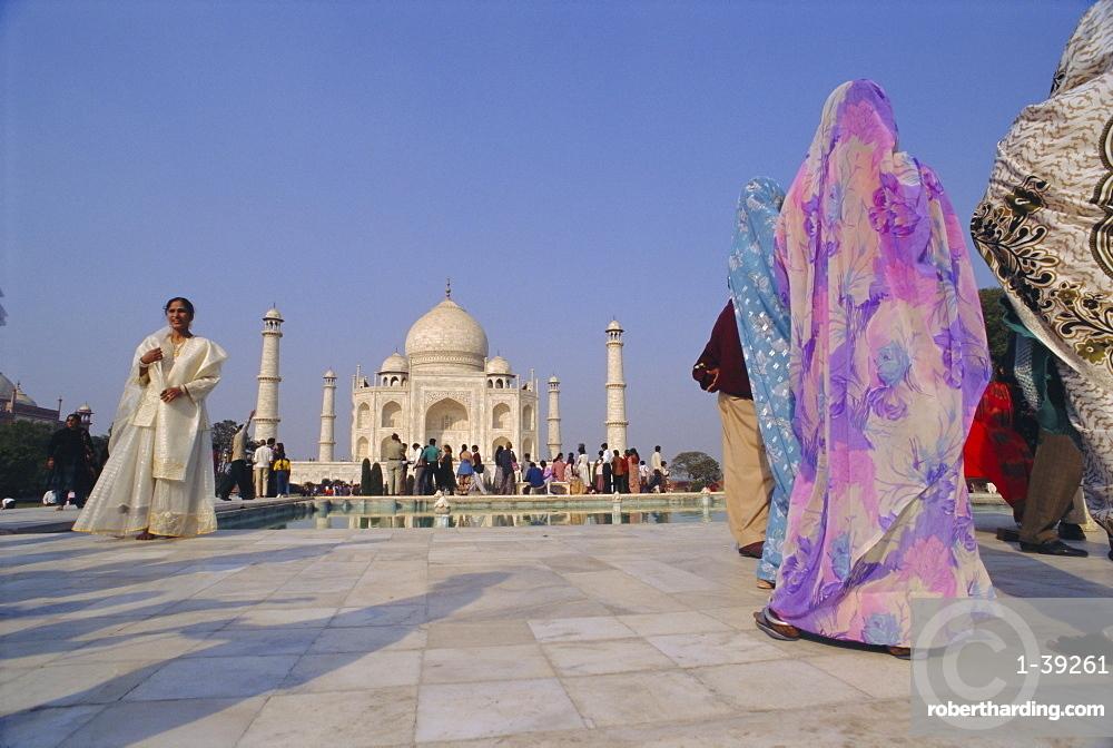 Indian tourists at the Taj Mahal, built by the Moghul emperor Shah Jehan (Jahan), Agra, Uttar Pradesh, India