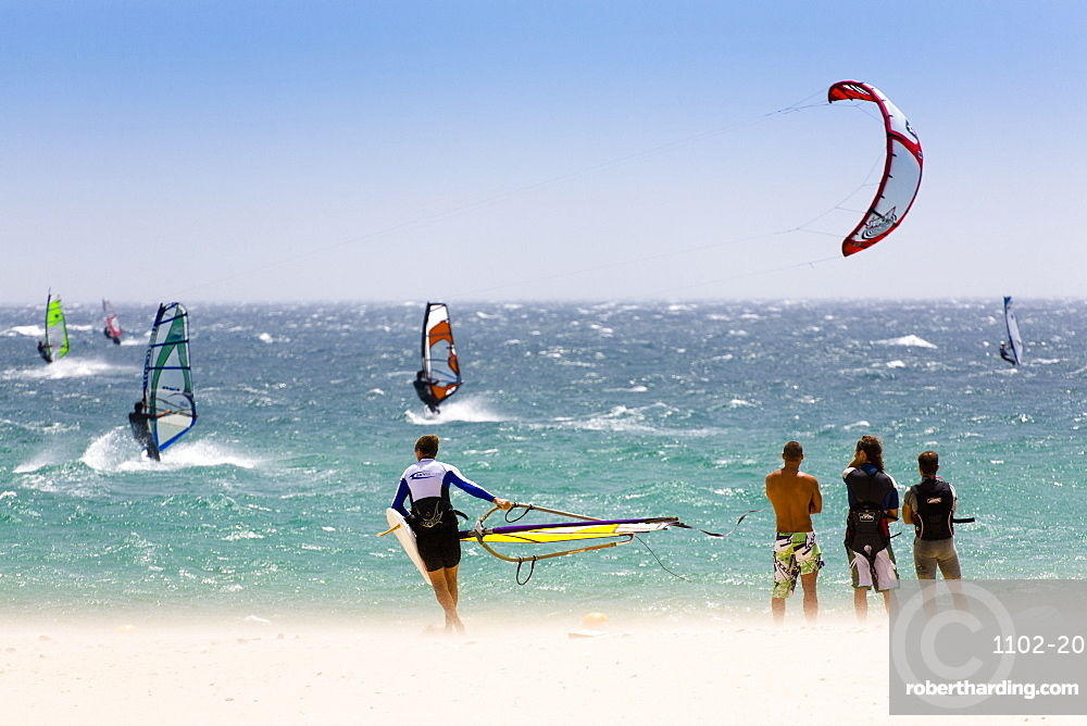 Spectators watching windsurfing in high Levante winds in the Strait of Gibraltar, Valdevaqueros, Tarifa, Andalucia, Spain, Europe