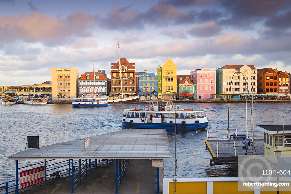 View of Otrobanda ferry terminal and Dutch colonial buildings on Handelskade along Punda's waterfront, UNESCO World Heritage Site, Willemstad, Curacao, West Indies, Lesser Antilles, former Netherlands Antilles, Caribbean, Central America