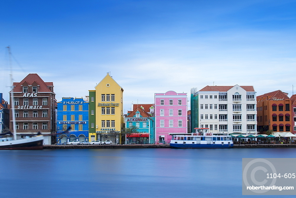View of St. Anna Bay looking towards colonial merchant houses lining Handelskade along Punda's waterfront, UNESCO World Heritage Site, Willemstad, Curacao, West Indies, Lesser Antilles, former Netherlands Antilles, Caribbean, Central America